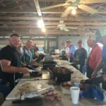 The Rifle Hall Members and friends spend the previous day and night preparing brisket for the meal.