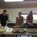 Family & friends of the Rifle Hall help serve guests.